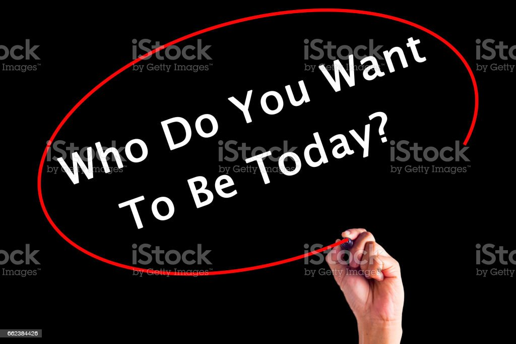 Hand Writing Who Do You Want to be Today with a marker over transparent board stock photo
