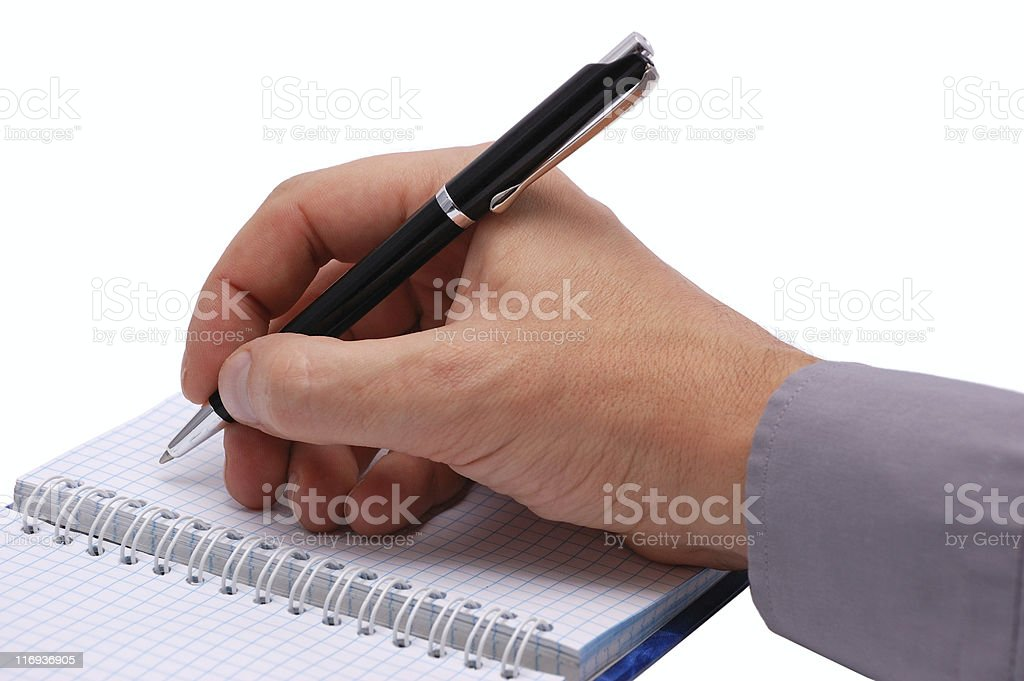 Hand writing with a pen royalty-free stock photo