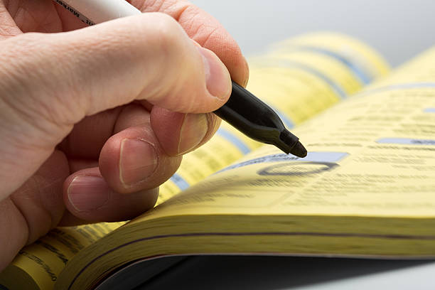 Hand writing with marker Hand writing with black marker on phone book telephone directory stock pictures, royalty-free photos & images