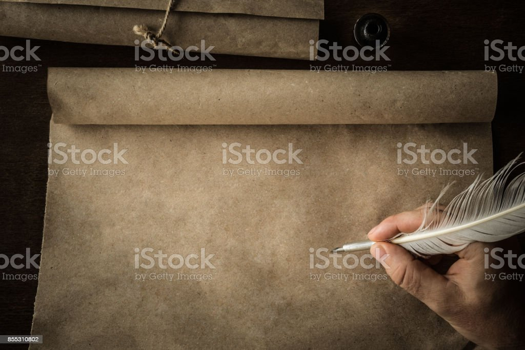 Hand writing with old quill pen on the old paper. Historical atmosphere. Empty place for a text. stock photo