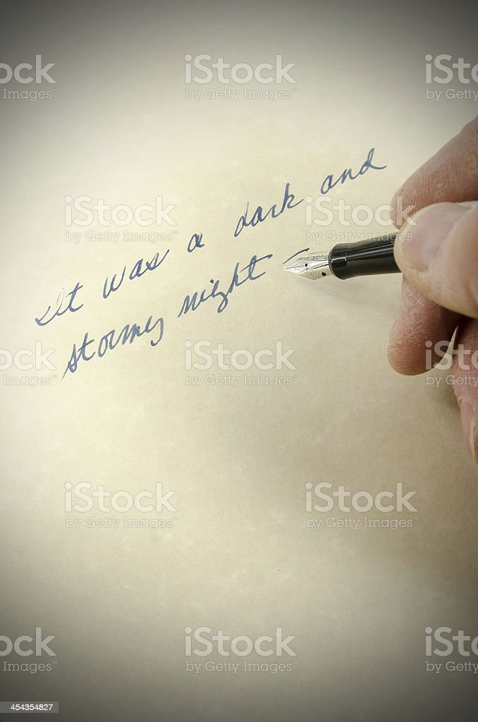hand written note 'It was a dark and stormy night' stock photo