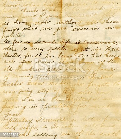 An old hand written letter that has a grunge appeal from water damage.