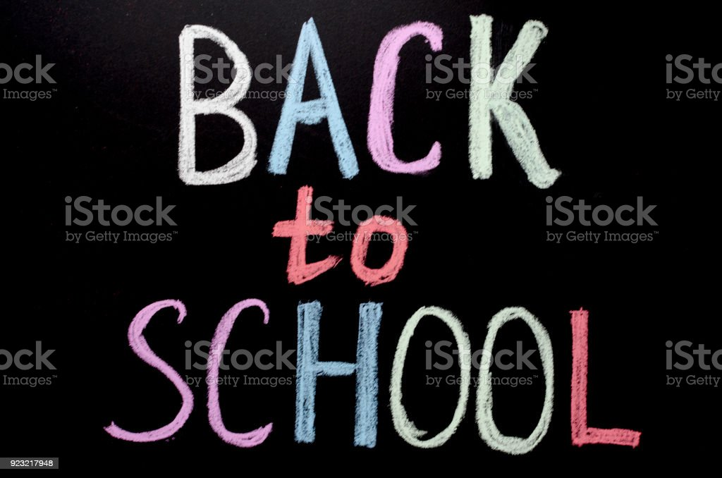hand writting text 'back to shcool' on chalkboard stock photo