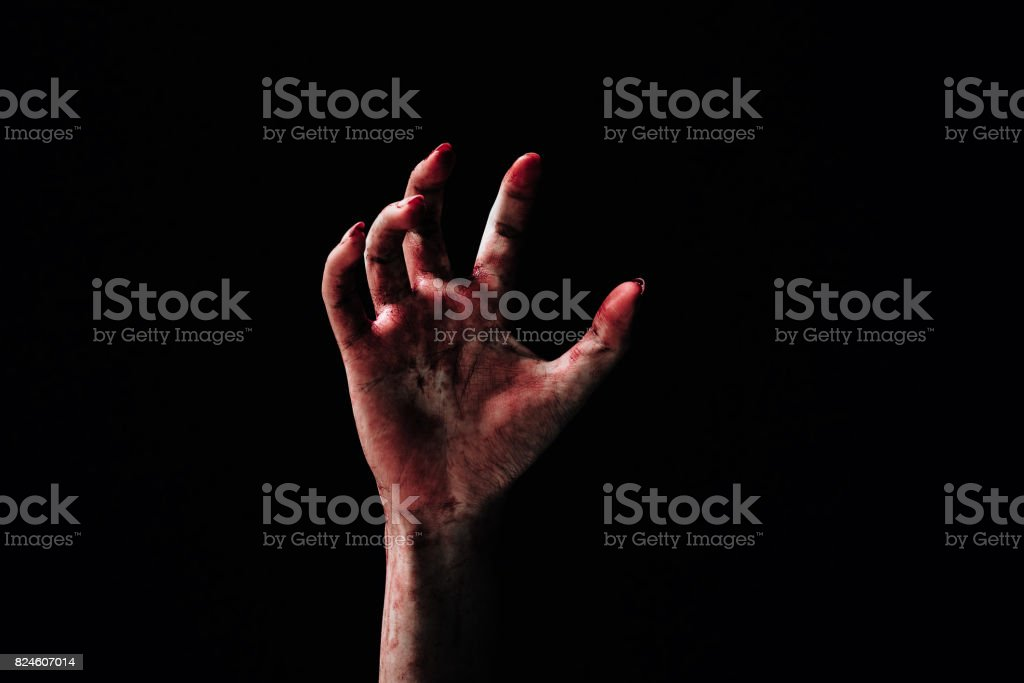 Hand zombie death with blood touching stair on nightmare darkness background, horror halloween festival concept stock photo