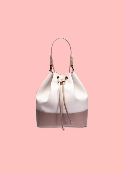 handbag isolated on pink background - borsetta foto e immagini stock