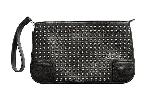 Handbag Black leather handbag with metal rivets isolated over white studded stock pictures, royalty-free photos & images