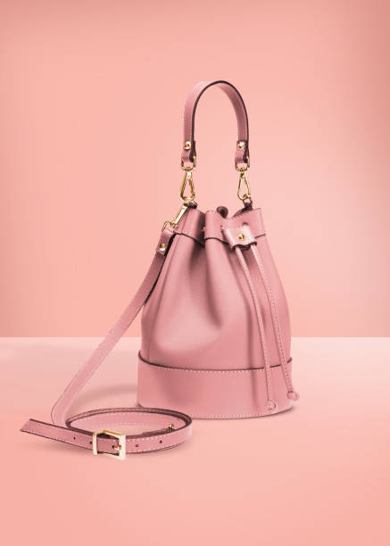 handbag with clipping path on a pastel background - borsetta foto e immagini stock