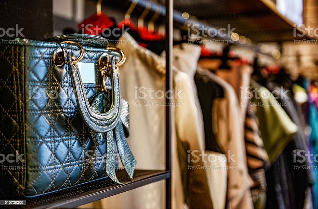 Handbags and clothes in a fashion store stock photo