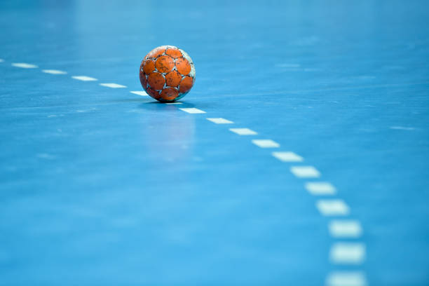 handball ball laying on the 9 meters dotted line - fotografia de stock