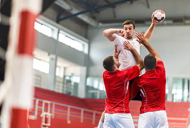 handball player jumping and shooting at goal. - handboll bildbanksfoton och bilder