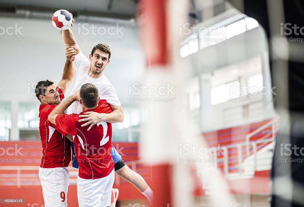Handball player shooting at goal. stock photo