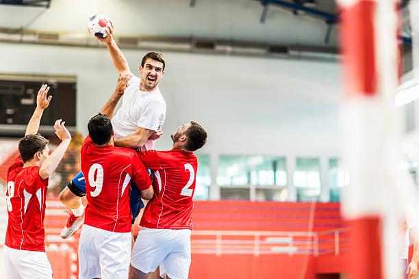 handball player shooting at goal. - handboll bildbanksfoton och bilder