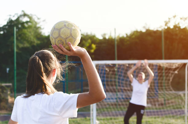 Handball player trowing a ball stock photo