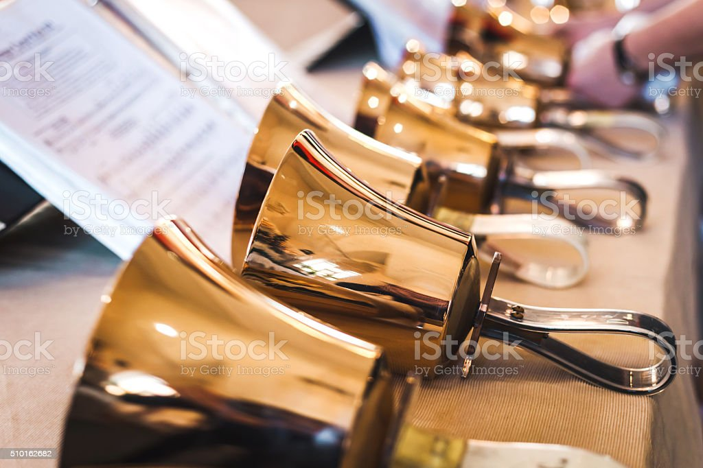 Handbells on table ready to perform stock photo