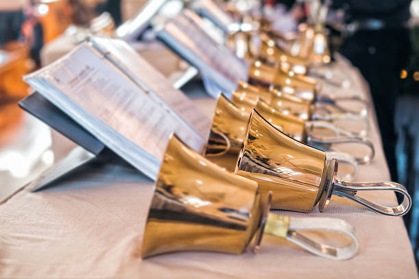 handbells with sheet of music - bell stock pictures, royalty-free photos & images