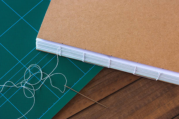 Handbound book with needle and thread stock photo