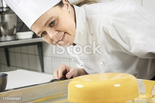 confectioner making cakes and chocolate in her confectionery