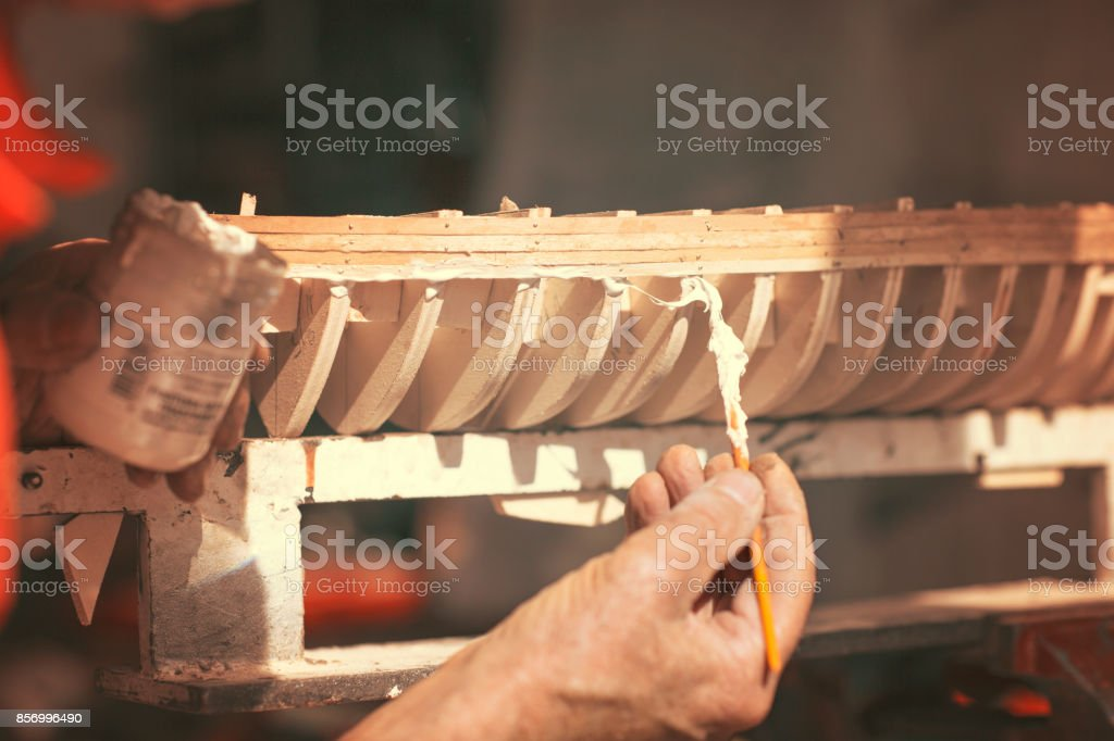 handcrafted craftwork of a wooden boat model stock photo