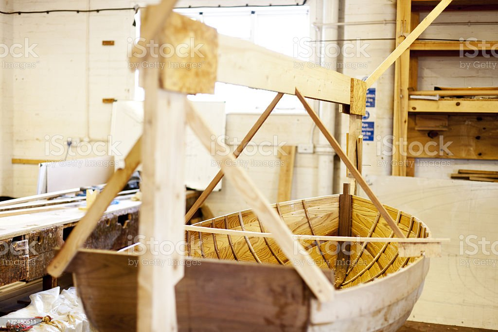Handcrafted wooden rowing boat stock photo