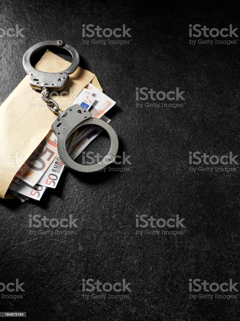 Handcuff and Euros in a Envelope royalty-free stock photo