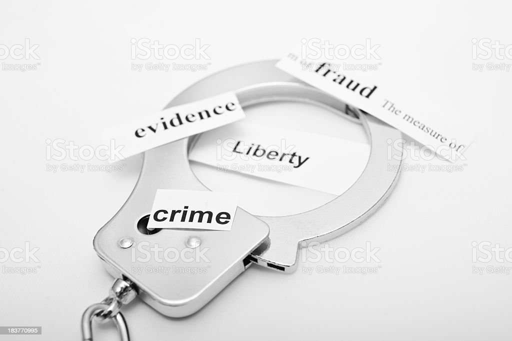 handcuff with notes stock photo