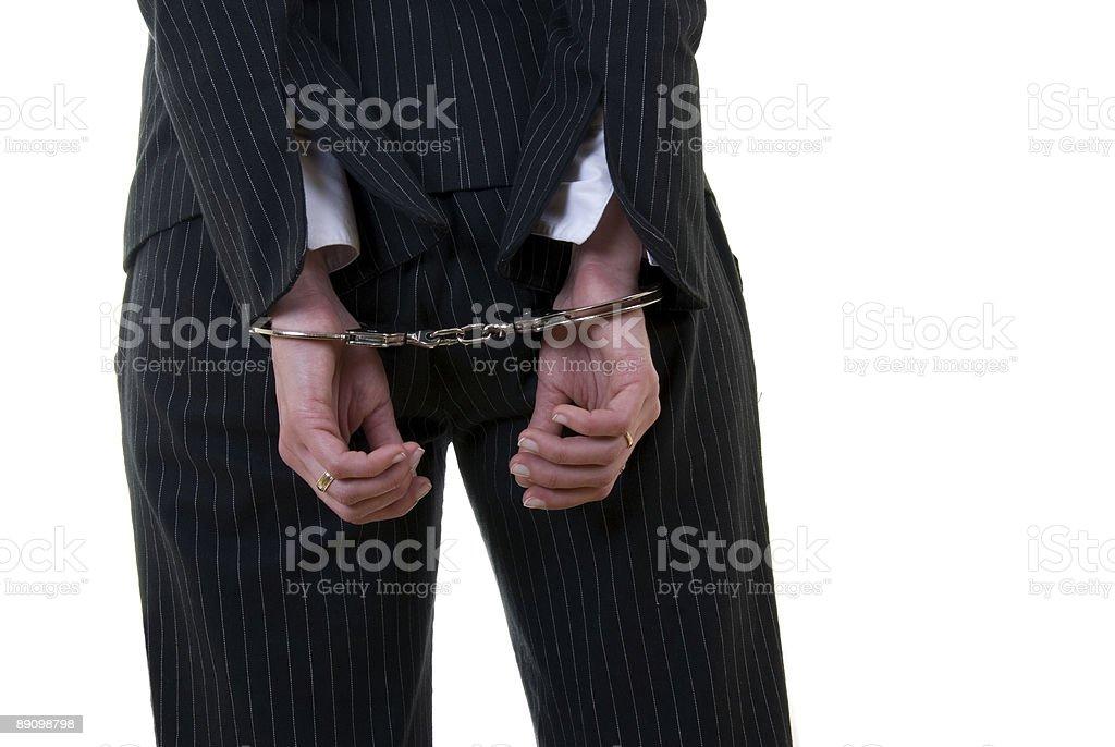 Handcuffed business woman royalty-free stock photo