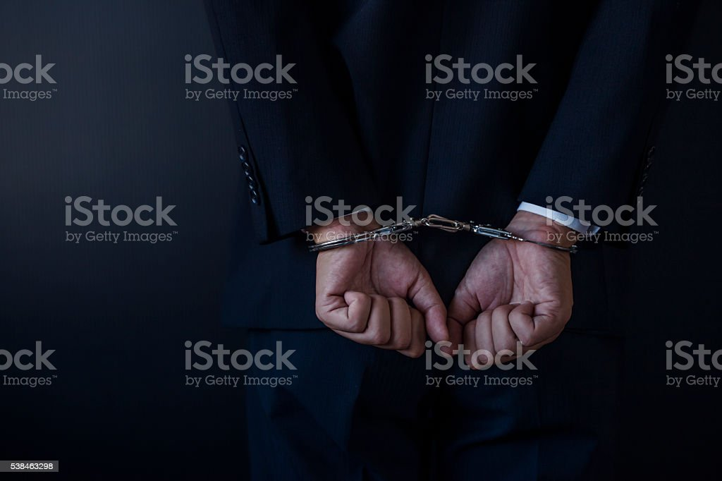 Handcuffed businessman stock photo