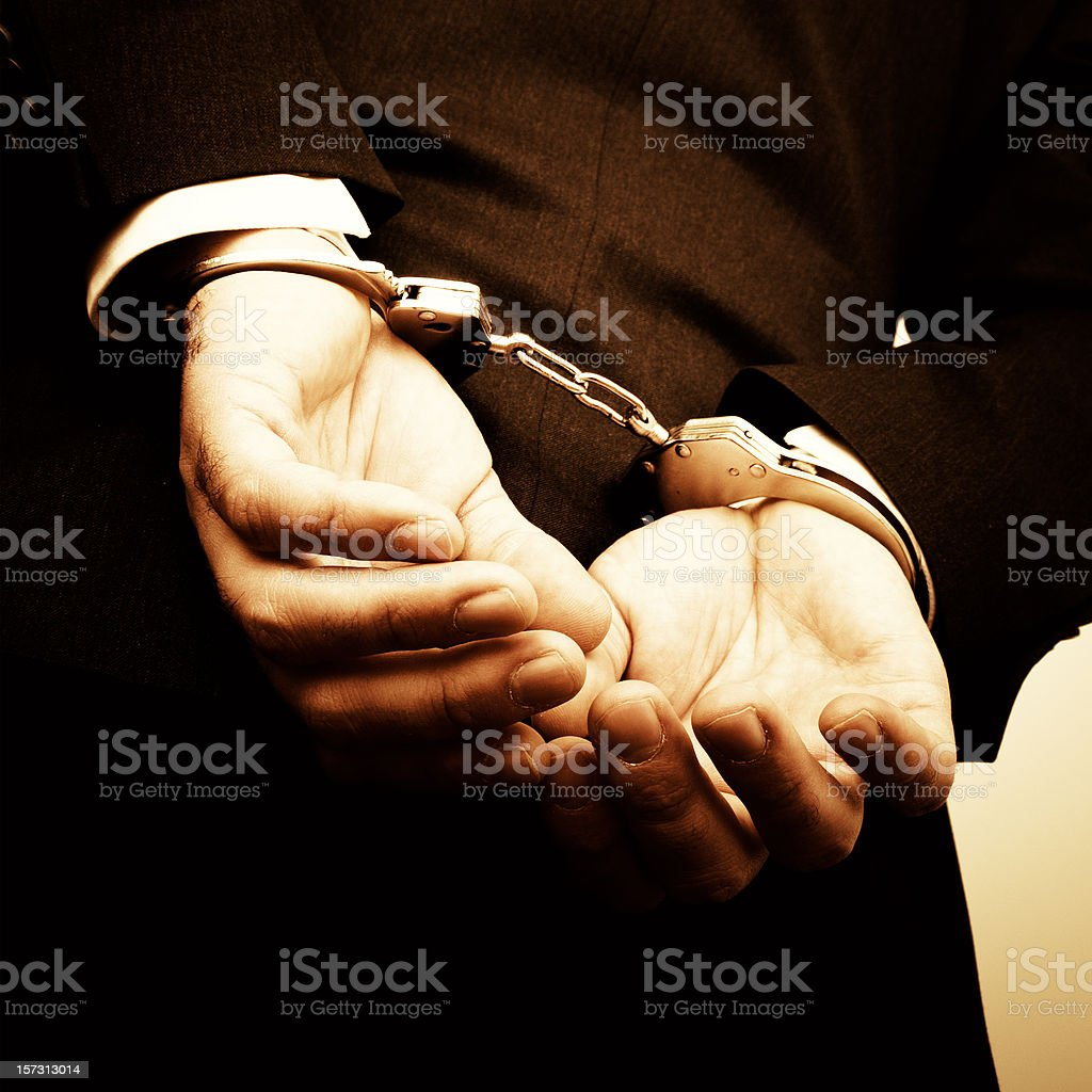 Handcuffed Hands royalty-free stock photo