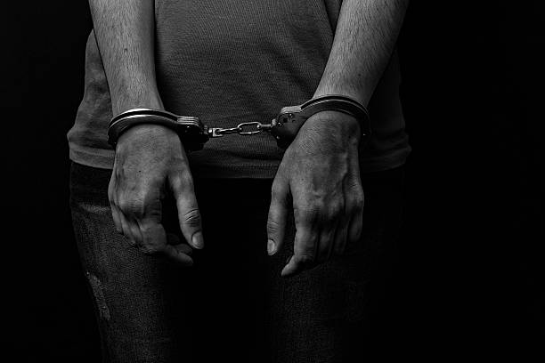 handcuffed the woman handcuffed the woman deportation stock pictures, royalty-free photos & images