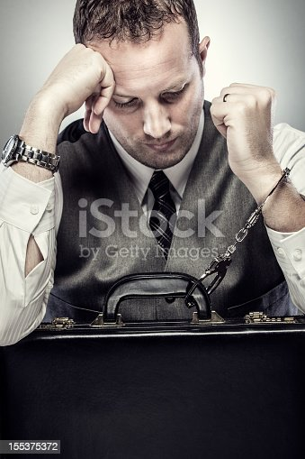 istock CEO Handcuffed to His Briefcase 155375372
