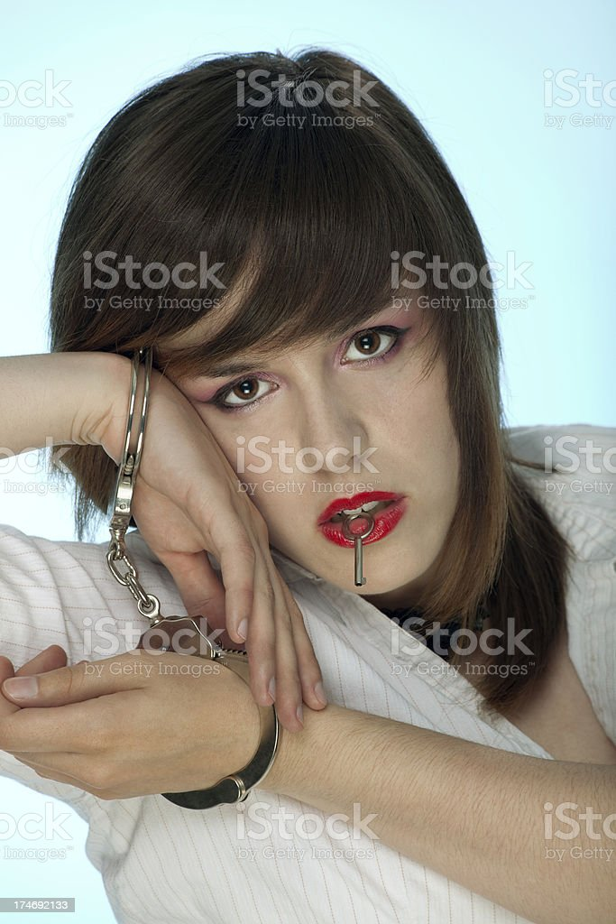 Handcuffed Woman Holds The Key royalty-free stock photo