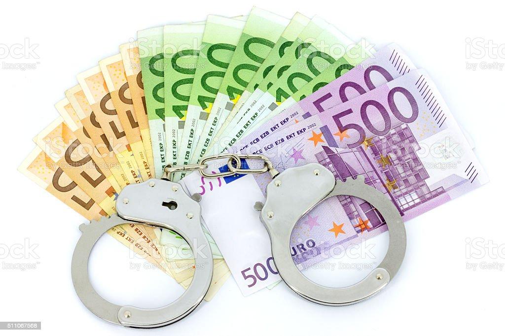 Handcuffs and diamond stock photo