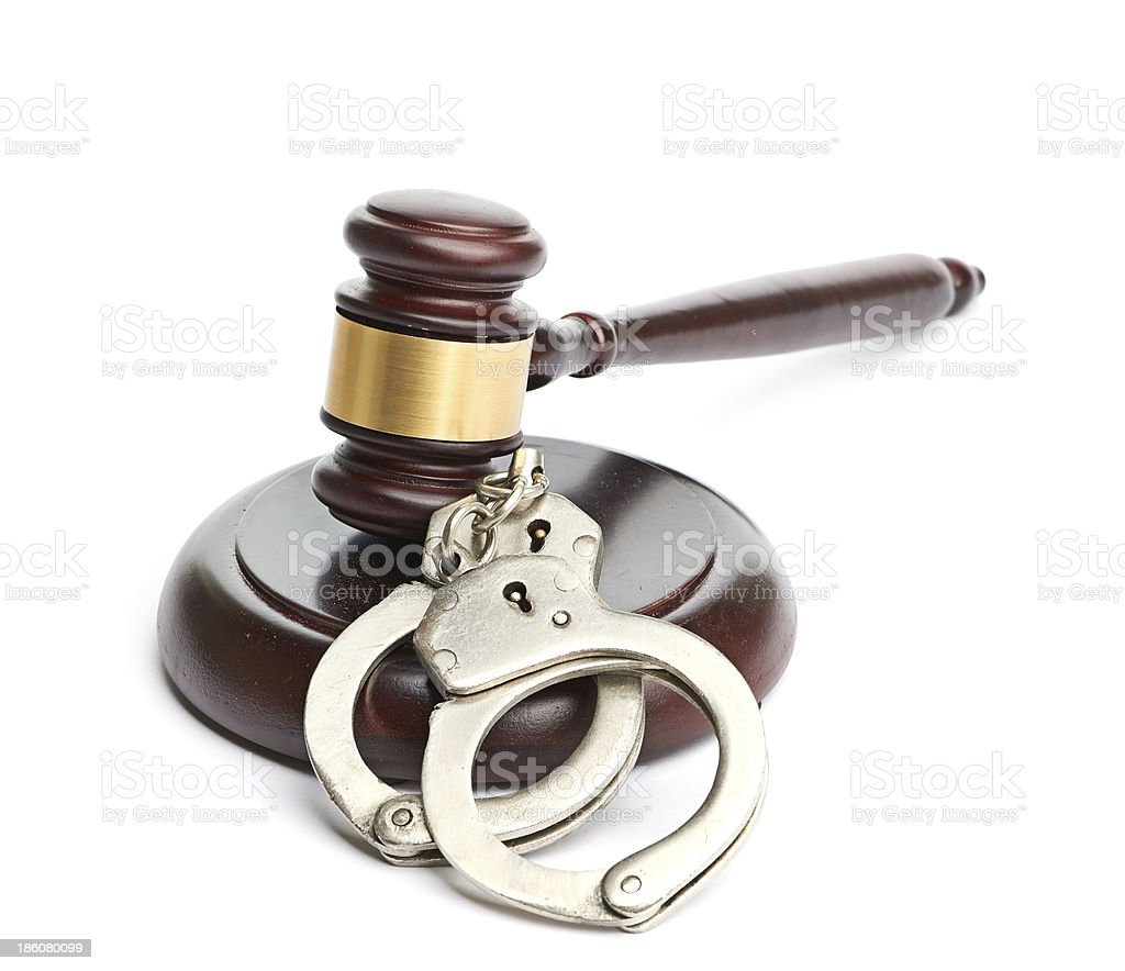 handcuffs and gavel royalty-free stock photo