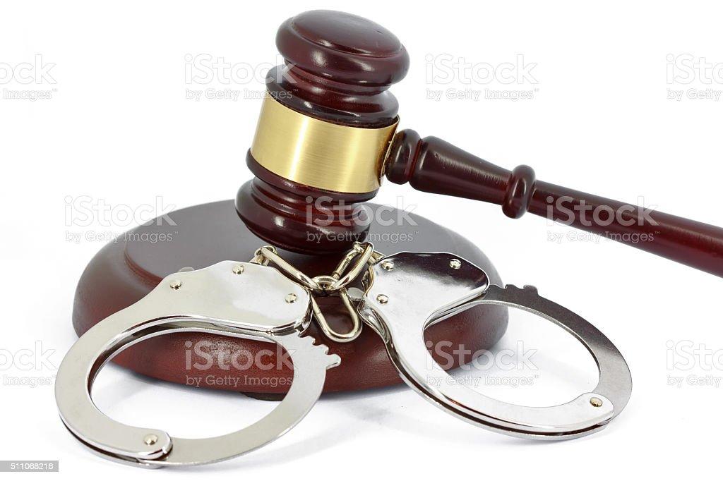 Handcuffs and gavel stock photo