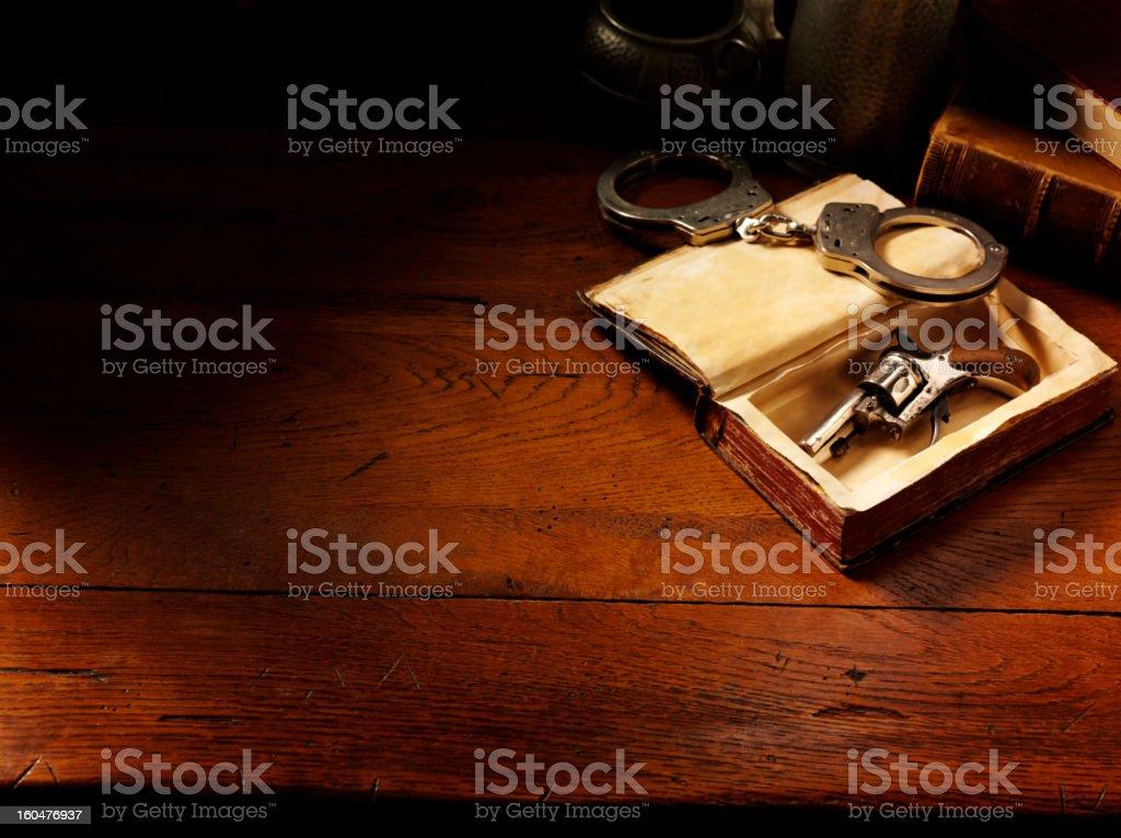 Handcuffs and Handgun in Vintage Style stock photo