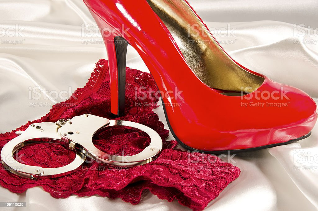 Handcuffs and high heel stock photo