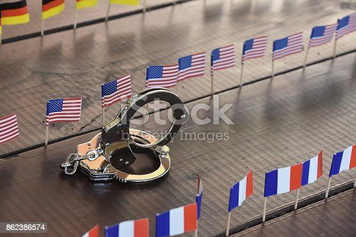 istock Handcuffs and international flags 862386574
