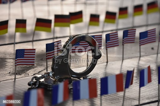 istock Handcuffs and international flags 862389200
