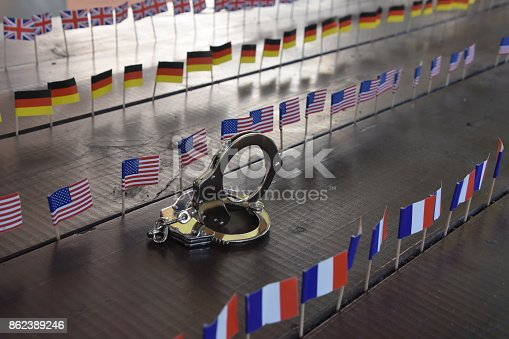 istock Handcuffs and international flags 862389246