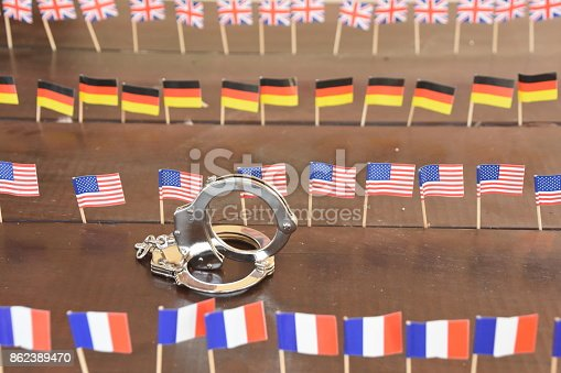 istock Handcuffs and international flags 862389470