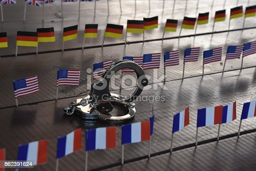 istock Handcuffs and international flags 862391624