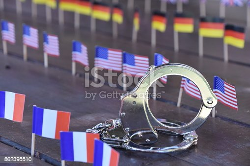 istock Handcuffs and international flags 862395510