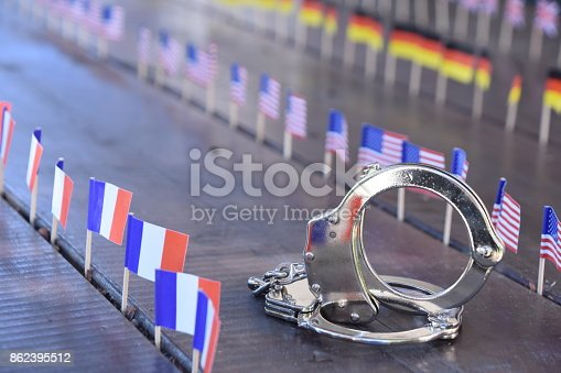 istock Handcuffs and international flags 862395512