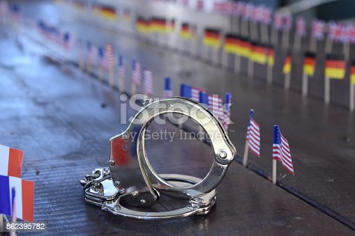 istock Handcuffs and international flags 862395782