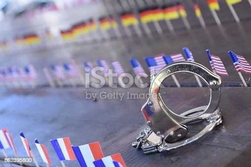 istock Handcuffs and international flags 862395800