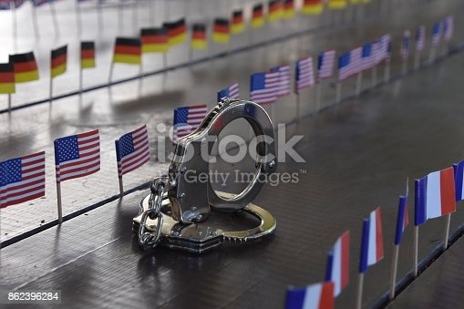 istock Handcuffs and international flags 862396284