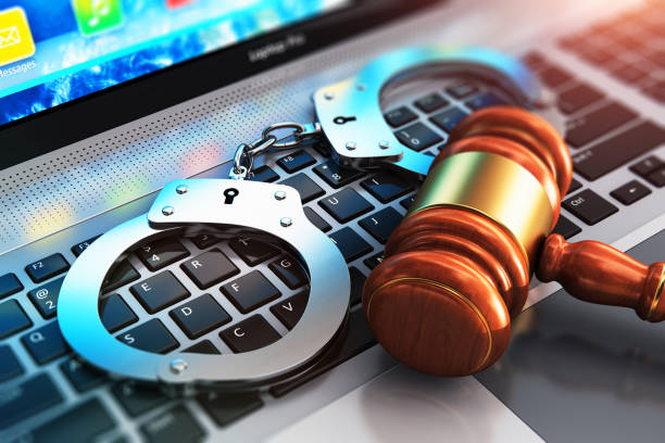 Handcuffs and judge mallet on laptop keyboard Creative abstract cyber crime, online piracy and internet web hacking concept: 3D render illustration of the macro view of metal handcuffs and wooden judge mallet, gavel or hammer on laptop notebook computer keyboard with selective focus effect crime stock pictures, royalty-free photos & images