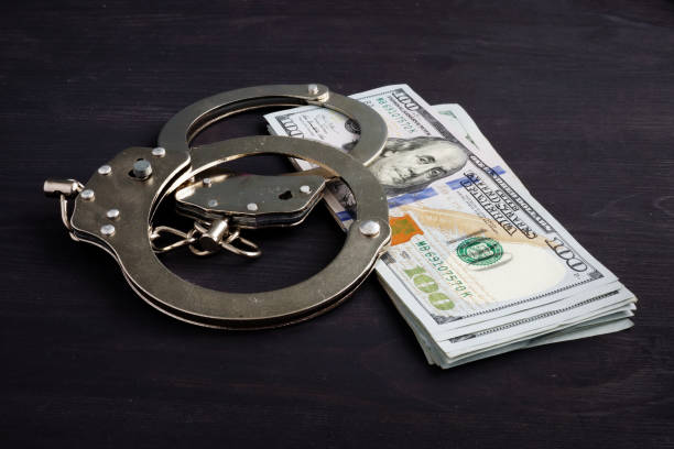 Handcuffs and money. Dollars for bail bonds. stock photo