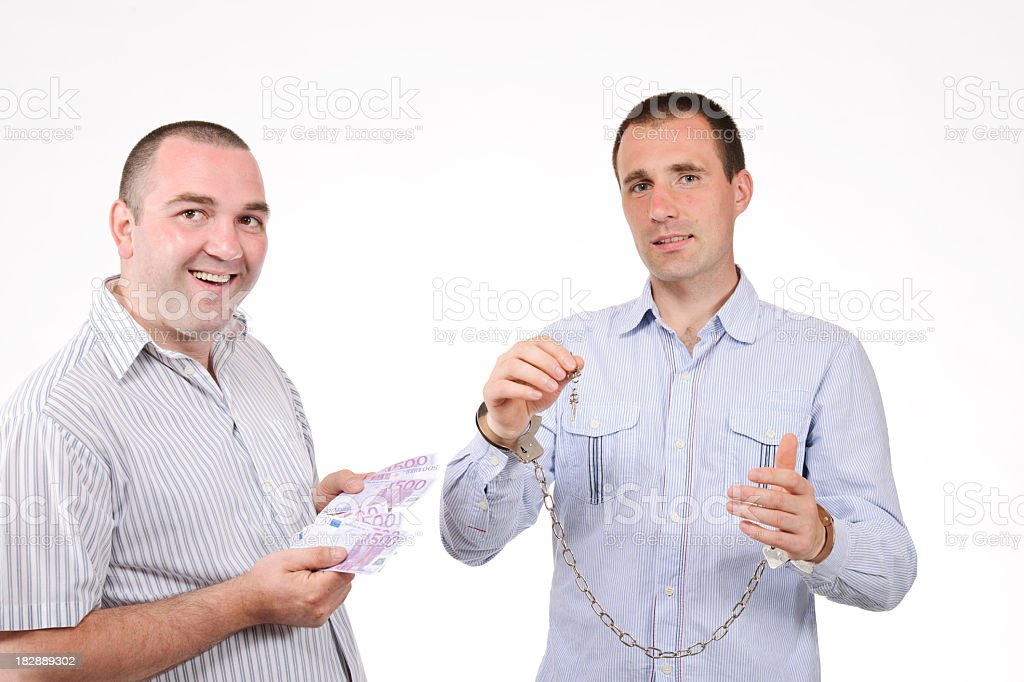 handcuffs and money royalty-free stock photo