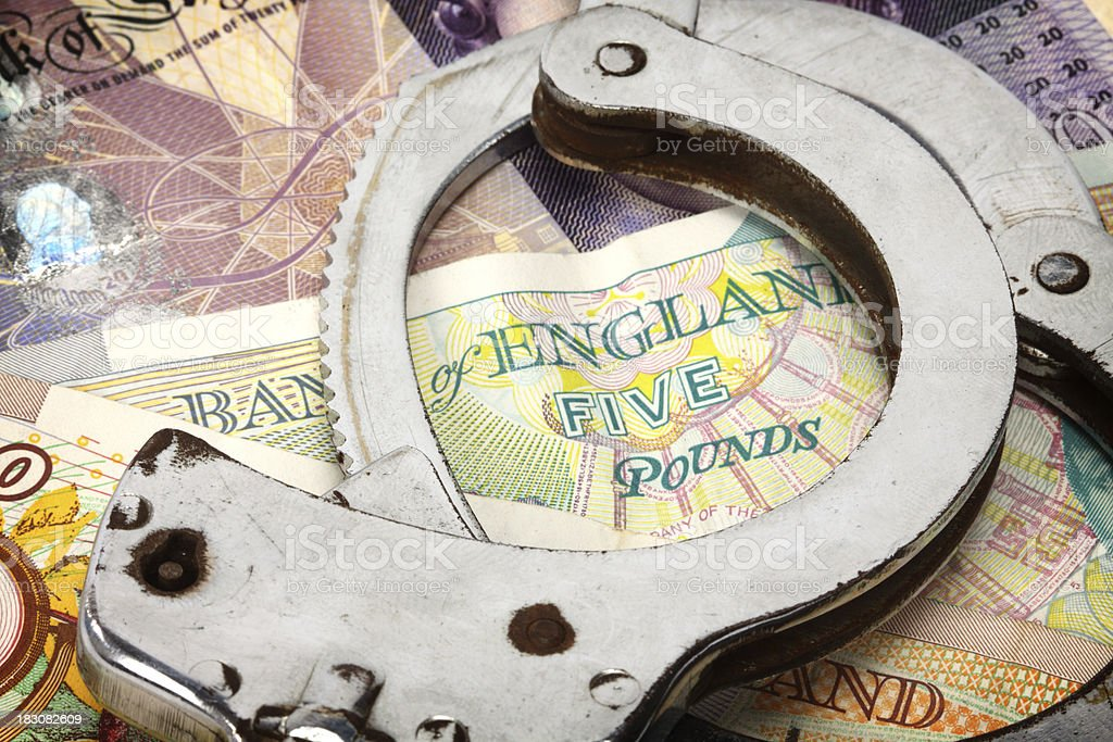 handcuffs and  money stock photo